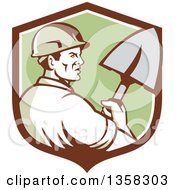 Clipart Of A Retro Male Construction Worker Builder Holding A Shovel In A Brown White And Green Shield Royalty Free Vector Illustration