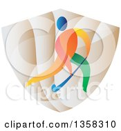 Clipart Of A Colorful Athlete Playing Field Hockey On A Shield Royalty Free Vector Illustration