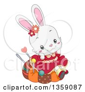 Clipart Of A Cute White Female Bunny Rabbit Sitting On A Pin Cushion And Daydreaming Royalty Free Vector Illustration by BNP Design Studio