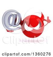 3d Red Devil Head Holding Up A Finger And An Email Arobase At Symbol On A White Background