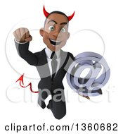 Clipart Of A 3d Young Black Devil Businessman Holding An Email Arobase At Symbol And Flying On A White Background Royalty Free Illustration