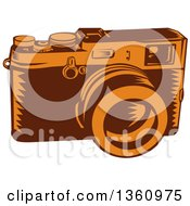 Clipart Of A Retro Woodcut Brown And Orange 35mm Camera Royalty Free Vector Illustration