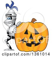 Clipart Of A Lancer School Mascot Smiling By A Halloween Jackolantern Pumpkin Royalty Free Vector Illustration by Toons4Biz