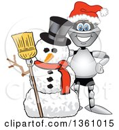 Clipart Of A Lancer School Mascot Wearing A Santa Hat And Smiling By A Christmas Snowman Royalty Free Vector Illustration