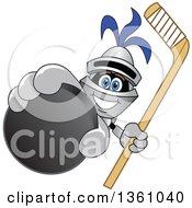 Clipart Of A Lancer School Mascot Holding Up A Stick And A Hockey Puck Royalty Free Vector Illustration by Toons4Biz