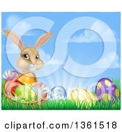 Clipart Of A Cute Beige Bunny Rabbit With A Basket And Easter Eggs In Grass Against A Blue Sky With Puffy Clouds And Sun Rays Royalty Free Vector Illustration