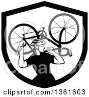 Clipart Of A Black And White Retro Male Cyclist Carrying A Bicycle On His Back Inside A Shield Royalty Free Vector Illustration