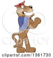 Cougar School Mascot Character Riveter Wearing A Bandana And Flexing Muscles Symbolizing Determination