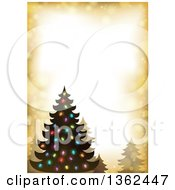 Clipart Of A Silhouetted Christmas Tree With Colorful Lights On A Golden Flare Border Royalty Free Vector Illustration