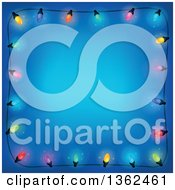 Clipart Of A Border Of Colorful Christmas Lights Over Blue With Text Space Royalty Free Vector Illustration