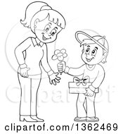 Clipart Of A Cartoon Black And White Thoughtful Boy Giving His Mom A Flower On Mothers Day Royalty Free Vector Illustration by visekart