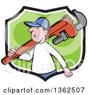 Cartoon White Male Plumber Holding A Giant Monkey Wrench Over His Shoulder In A Black White And Green Shield