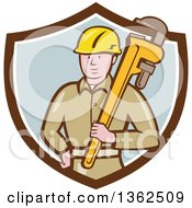 Clipart Of A Retro Cartoon White Male Plumber Holding A Giant Monkey Wrench In A Brown White And Pastel Blue Shield Royalty Free Vector Illustration