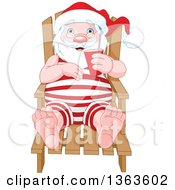 Relaxed Santa Claus Sitting In A Beach Chair And Holding A Beverage While Sun Bathing