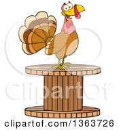 Clipart Of A Cartoon Turkey Bird On A Giant Wooden Spool Royalty Free Vector Illustration by Hit Toon
