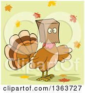 Clipart Of A Cartoon Thanksgiving Turkey Bird Wearing A Bag Over His Head With Autumn Leaves On Green Royalty Free Vector Illustration by Hit Toon
