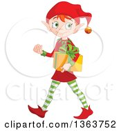 Clipart Of A Happy Male Red Haired Christmas Elf Walking And Carrying A Gift Royalty Free Vector Illustration by Pushkin