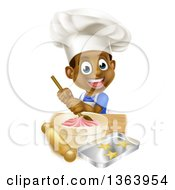 Clipart Of A Cartoon Happy Black Boy Making Frosting And Star Cookies Royalty Free Vector Illustration