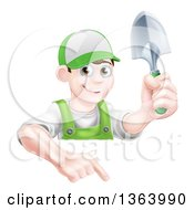 Clipart Of A Happy Young Brunette White Male Gardener In Green Pointing Down Over A Sign And Holding A Shovel Royalty Free Vector Illustration