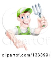 Clipart Of A Middle Aged Brunette White Male Gardener In Green Holding A Garden Fork And Pointing Down Over A Sign Royalty Free Vector Illustration