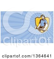 Clipart Of A Retro Worker Man Holding A Sledgehammer Over A Shield And Blue Rays Background Or Business Card Design Royalty Free Illustration