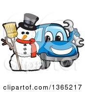 Happy Blue Car Mascot Holding A Wrench By A Christmas Snowman