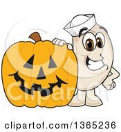 Clipart Of A Navy Bean Mascot Character By A Halloween Jackolantern Pumpkin Royalty Free Vector Illustration