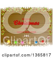 Clipart Of A Merry Christmas And Happy New Year Greeting On Wood With Snow Holly And Light Borders Royalty Free Vector Illustration by elaineitalia
