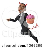 Clipart Of A 3d Young Black Devil Business Man Holding A Cupcake Flying And Pointing On A White Background Royalty Free Illustration