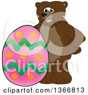 Clipart Of A Grizzly Bear School Mascot Character With An Easter Egg Royalty Free Vector Illustration