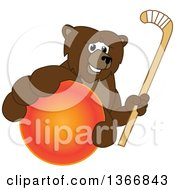 Clipart Of A Grizzly Bear School Mascot Character Grabbing A Ball And Holding A Hockey Stick Royalty Free Vector Illustration by Toons4Biz