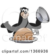 Clipart Of A Black Bear School Mascot Character Serving A Roasted Thanksgiving Turkey Royalty Free Vector Illustration by Toons4Biz