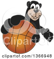 Clipart Of A Black Bear School Mascot Character Grabbing A Basketball Royalty Free Vector Illustration by Toons4Biz