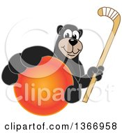 Clipart Of A Black Bear School Mascot Character Grabbing A Ball And Holding A Hockey Stick Royalty Free Vector Illustration by Toons4Biz