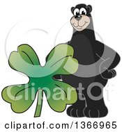 Clipart Of A Black Bear School Mascot Character With A Four Leaf St Patricks Day Clover Royalty Free Vector Illustration by Toons4Biz