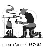 Clipart Of A Black Silhouetted Cowboy Kneeling And Making Coffee Over A Camp Fire Royalty Free Vector Illustration by Andy Nortnik