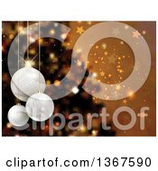 Clipart Of A Christmas Background Of 3d Suspended Baubles Over A Blurred Tree Stars And Bokeh On Gold Royalty Free Vector Illustration