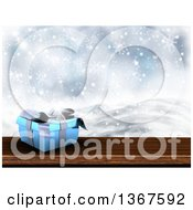 3d Short Blue Gift Box On Wood Over A Snowy Landscape