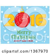 Santa Face On A Bauble In A Red New Year 2016 Over Snow And A Merry Christmas Happy New Year Greeting On Blue