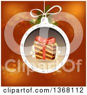 Clipart Of A Christmas Bauble With A Gift Over Red Royalty Free Vector Illustration