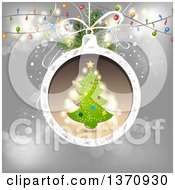 Clipart Of A Tree In A Christmas Bauble Frame Over Gray With Lights Royalty Free Vector Illustration