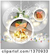 Gift And Bells In Christmas Bauble Frames Over Gray With Lights