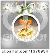 Clipart Of Bells In A Christmas Bauble Frame Over Gray With Lights Royalty Free Vector Illustration