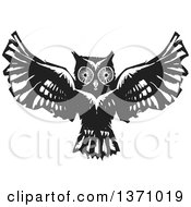 Clipart Of A Black And White Woodcut Flying Owl Royalty Free Vector Illustration by xunantunich
