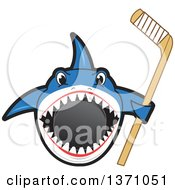 Clipart Of A Shark School Mascot Character Biting A Hockey Puck And Holding A Stick Royalty Free Vector Illustration