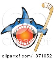 Shark School Mascot Character Biting A Hockey Ball And Holding A Stick