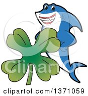 Shark School Mascot Character With A St Patricks Day Four Leaf Clover