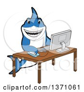 Shark School Mascot Character Using A Desktop Computer