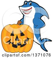 Shark School Mascot Character With A Jackolantern Pumpkin