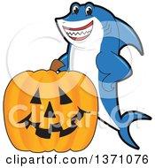 Shark School Mascot Character With A Jackolantern Pumpkin